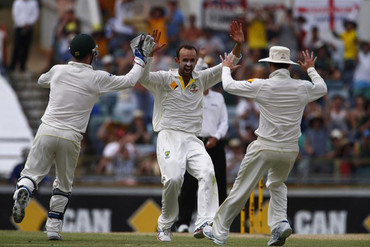 Australia's Nathan Lyon (C) celebrates with captain Michael Clarke (R) and Brad Haddin after taking the wicket of England's Graeme Swann (Reuters)