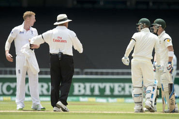 Match umpire Marais Erasmus holds back England bowler Ben Stokes (left) during a verbal altercation with Australian batsman Brad Haddin (right) (AAP)