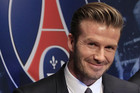 David Beckham has signed with PSG and is donating his salary to charity (Reuters)