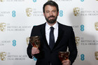 Ben Affleck holding BAFTA trophies for his film Argo