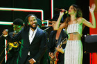 Rihanna and Ziggy Marley performing at the 2013 Grammy Awards (Reuters)