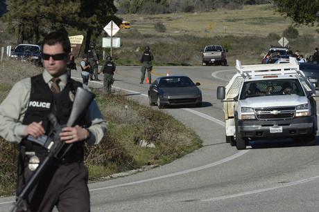Police at a road block on Highway 38 into the Big Bear area after a shootout with suspected fugitive Christopher Dorner (AAP)
