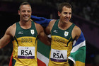 Oscar Pistorius (L) and Arnu Fourie (R) after winning gold at the 2012 London Paralympics