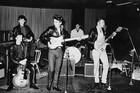 Tony Sheridan (left) with the Beatles in the early 1960s
