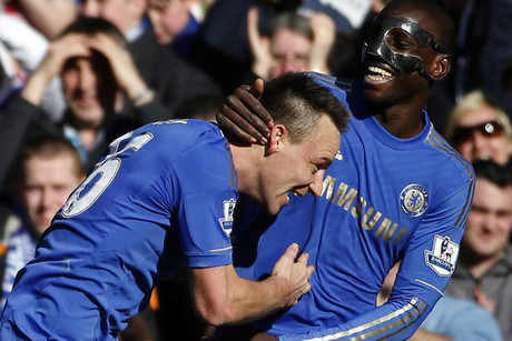 Chelsea's John Terry, left, celebrates his goal against Brentford with Demba Ba (Reuters)