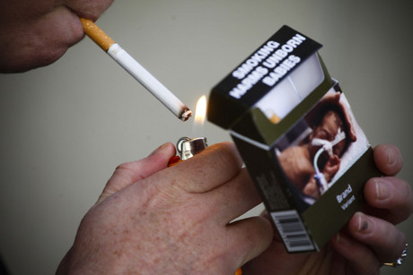 The Government will first wait to see what happens with legal action on plain packaging in Australia (AAP)