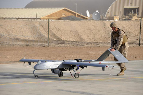 A US Marine with Marine Unmanned Aerial Vehicle Squadron 1 pushes an RQ-7B Shadow UAV following its landing at Camp Leatherneck, Afghanistan (Reuters)