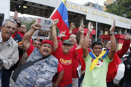 Supporters of Hugo Chavez cheer outside the military hospital after his surprise return to Caracas (Reuters)