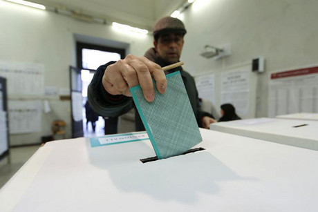 A man casts his vote at a polling station in Rome (Reuters)