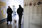 People arrive to vote in a polling station in Rome (Reuters)