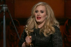 Adele accepting her Oscar