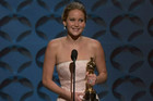 Jennifer Lawrence accepting her Oscar statuette