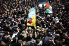 Palestinians carry the body of Arafat Jaradat during his funeral in the West Bank village of Se'eer, near Hebron (Reuters)