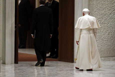 Pope Benedict XVI leaves at the end of his general audience in Paul VI hall at the Vatican, February 13 (Reuters)