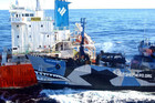 Sea Shepherd vessel Bob Barker (R) collides with the fuel tanker ship Sun Laurel as Japanese mother survey ship Nissin Maru (R) tries to pull alongside in the Antarctica (Reuters)