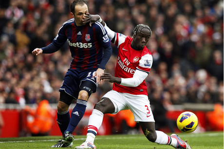 Mathew Etherington of Stoke and Arsenal's Bacary Sagna fight it out (Reuters)