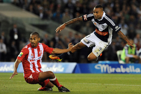 Archie Thompson of Melbourne Victory attempts a shot at goals against Patrick Gerhardt of Melbourne Heart (NZN)