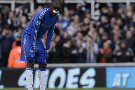 An injured Demba Ba looks on (Reuters)