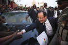 France's President Francois Hollande greets a cheering crowd at Independence Plaza in Bamako, Mali (Reuters)