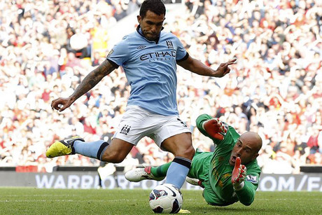 Carlos Tevez will be hoping he can round Reina in today's match and slot one away (Reuters file)