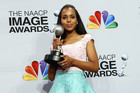 Kerry Washington holding one of her trophies (Reuters)