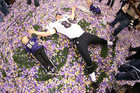 Baltimore Ravens tight end Billy Bajema (86) lies in the confetti on the field with his children as he celebrates (Reuters)