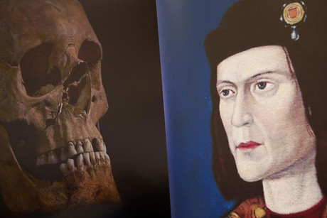 King Richard III's skull is seen next to a portrait of him (Reuters)