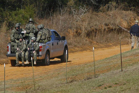 Law enforcement officials including the FBI are driven onto the scene of a shooting and hostage taking near Midland City, Alabama (Reuters)