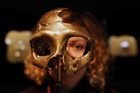 A girl looks through the replica of a neanderthal skull displayed in the Neanderthal Museum in the northern town of Krapina (Reuters file)
