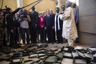 France's President Francois Hollande (5thR) flanked by Mali's interim president Dioncounda Traore (3dR), French Foreign Affairs minister Laurent Fabius (4thR) and UNESCO general director Irina Bokova (C) visit the archives where documents were burnt in Timbuktu during his one-day visit in Mali (Reuters)