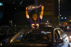 Baltimore Ravens fans celebrate the team's NFL Super Bowl XLVII victory over the San Francisco 49ers in Baltimore, Maryland (Reuters)