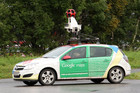 A Google Street View car taking photos (Reuters)