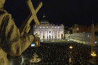 Faithful wait in St Peter's Square (Reuters)