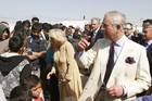 Prince Charles (R) and his wife Camilla (C) visit Syrian refugees in Jordan (Reuters)