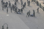 Egyptian army soldiers arrest protesters during clashes at Tahrir Square in Cairo December 17, 2011 (Reuters)