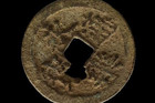 The coin is made of copper and silver and has a square hole in the centre