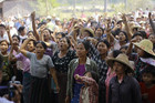 Villagers protest against an investigation commission's report on a copper mine project in Sarlingyi township (Reuters)