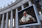 Newly elected Pope Francis appears on a large screen as he leads a mass in the Sistine Chapel (Reuters)