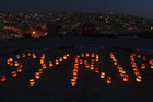 Syrian and local children form the word &quot;Syria&quot; with candles (Reuters)