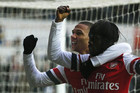 Gervinho celebrates his goal with Kieran Gibbs (Reuters)