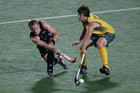 Dean Couzins of New Zealand (L) fights for the ball with Matt Gohdes of Australia (Reuters file)