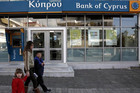 Cypriots face a levy on their bank deposits (Reuters)