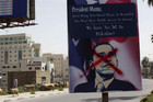 Unknown protesters put X on Obama placards in protest of his visit to Palestine (AAP)
