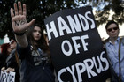 Protesters take part in an anti-bailout rally outside the Cyprus parliament in Nicosia (Reuters)