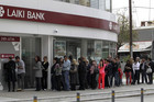 People queue to use an ATM in Nicosia, Cyprus (Reuters)