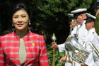 Thai Prime Minister Yingluck Shinawatra inspects the Royal New Zealand Navy band at Government House, in Auckland, on her first official trip to New Zealand. (Photo: Simon Wong/3 News)