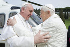 Pope Francis embraces Pope emeritus Benedict as he arrives at the papal summer residence  (Reuters)