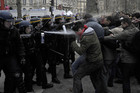 Riot police fire tear gas at protesters on the Champs-Elysees (AAP)