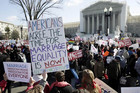 Supporters of gay marriage and traditional marriage demonstrate in front of the Supreme Court (Reuters)