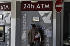 An ATM outside a branch of Laiki Bank in central Nicosia (Reuters file)